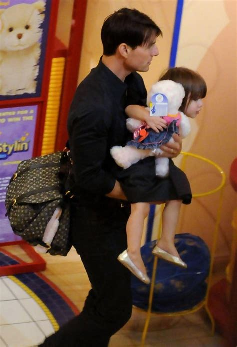 tom and suri cruise win a night at the cinderella castle suite in suri cruise in tom cruise and his daughter suri shopping
