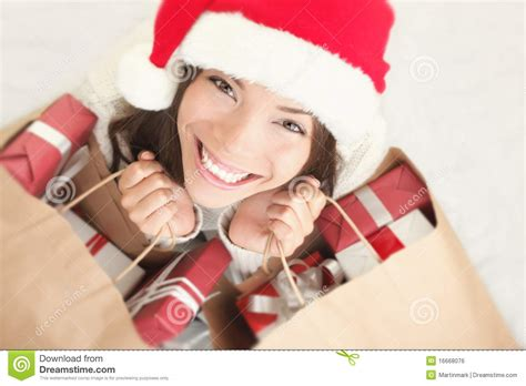 christmas shopping santa woman with gift bag royalty free
