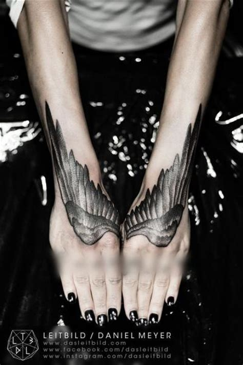 tattoo wings hand arm hand wings dotwork tattoo by leitbild