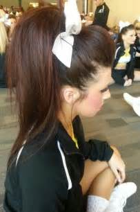 So big amp fabulous high teased brunette ponytail with a white cheer