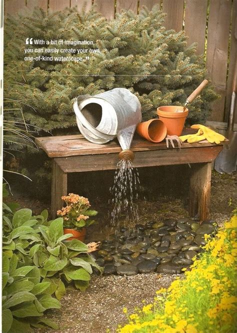 link garden water fountain from repurposed metal watering can bench perfect for cottage