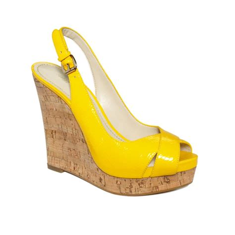 nine west laffnplay wedge sandals in yellow lyst