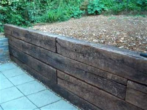 Patio Brick Laying Guides How To Build A Retaining Wall With Railway Sleepers