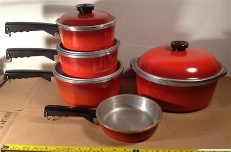 Alumunium Cookeware Set cookware pot lids and cherries on