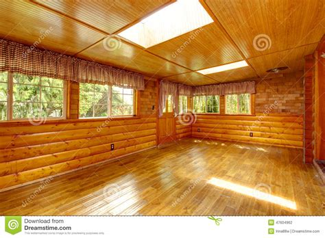 Cabin Plans With Basement bright empty log cabin house interior with skylights stock