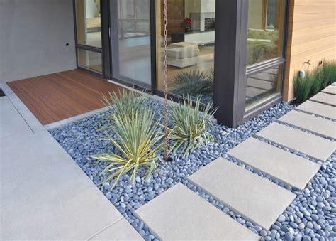 Concrete paving design landscape modern with river pebbles rain chain river pebbles