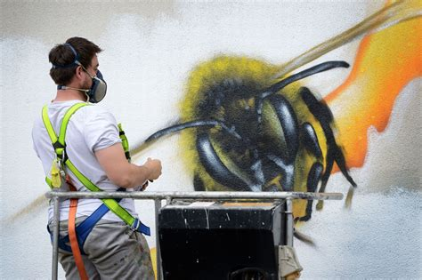 spray painters manchester manchester bees mural amazing mancunian tribute to the 22