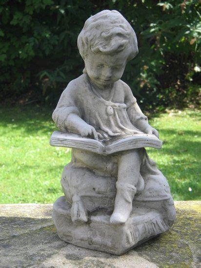boy reading garden ornament garden ornaments reading