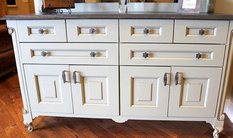 white cabinets with antique brass hardware opulent scroll knobs and pulls antique brass traditional
