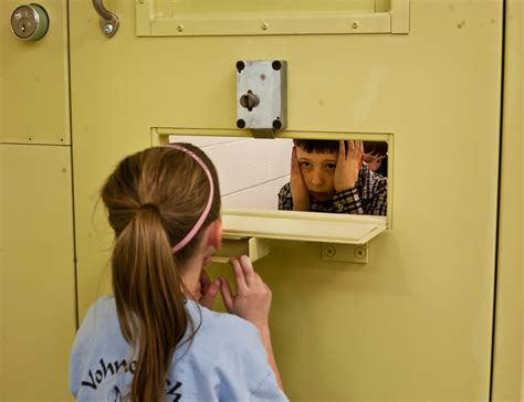 Nine year old landon robinson of marion looks through a hatch in a