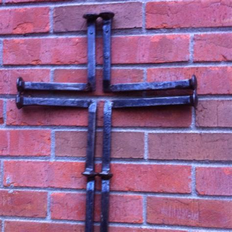 cross made with railroad ties ironworks
