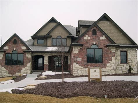 house with brick and siding brick and shingle siding brick or stone appearance let certified siding