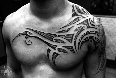 tribal tattoo on chest and shoulder sick tattoos on creativity and shoulder