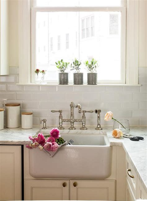 Ivory Kitchen Faucet ivory kitchen cabinets with beveled subway tile backsplash