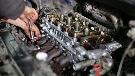 boat motor repair school hands of mechanic repairing gasoline car engine by wrench