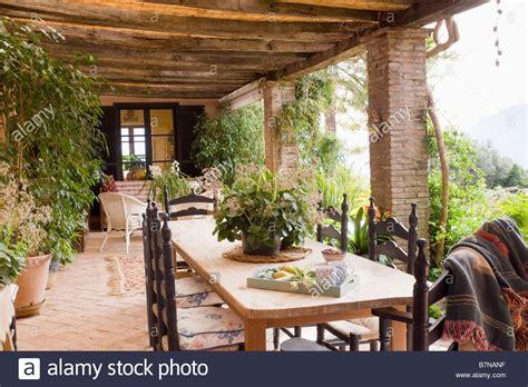 veranda villa wooden table and carved chairs on veranda of villa