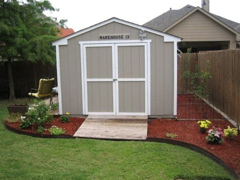 improve the looks of a storage shed landscape around the building