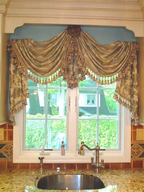 swag curtains for kitchen windows instead of just a valance or curtains why not hang a swag