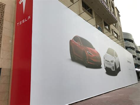elon musk dubai tesla starts deploying superchargers and destination