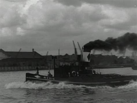 river thames boat names a tug boat moves along the river thames 1950 stock