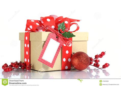 christmas gift wrapping with brown kraft gift box and red