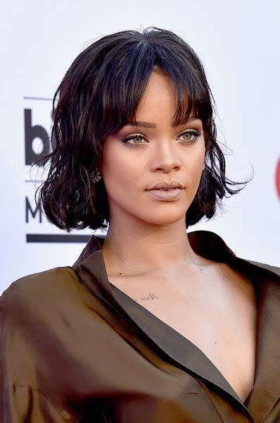 Rihanna Shows Us How Bangs Are Meant To Be Worn by Rihanna Wavy Cut Rihanna Hairstyles Lookbook