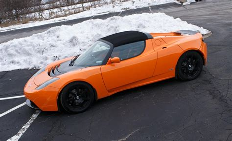 tesla roadster sport car and driver