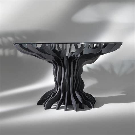 tavolo da pranzo tondo cassia piano in legno nero e top
