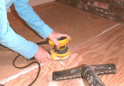 Sanding Plywood Floor by Painted Plywood Floors Bob Vila
