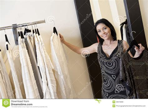 Womans Rack Portrait Of A Beautiful Mid Selecting Dress