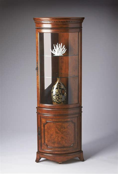 furniture corner curio cabinet buy masterpiece corner curio cabinet by butler from