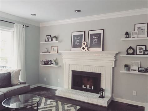 adding floating shelves by the fireplace