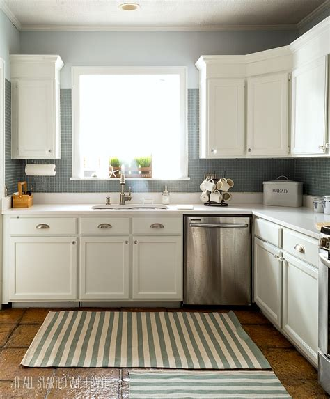 painted kitchen cabinets white how to paint builder grade cabinets