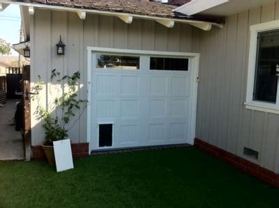 daily dose  doors garage door   doggy door installed