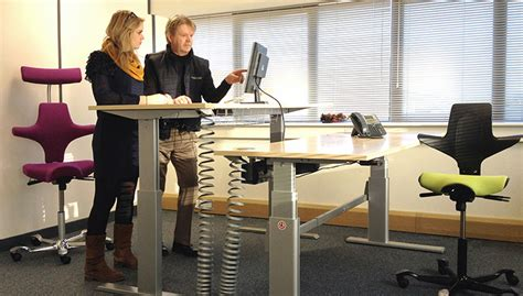 stand to sit desk back in sit stand desks back in
