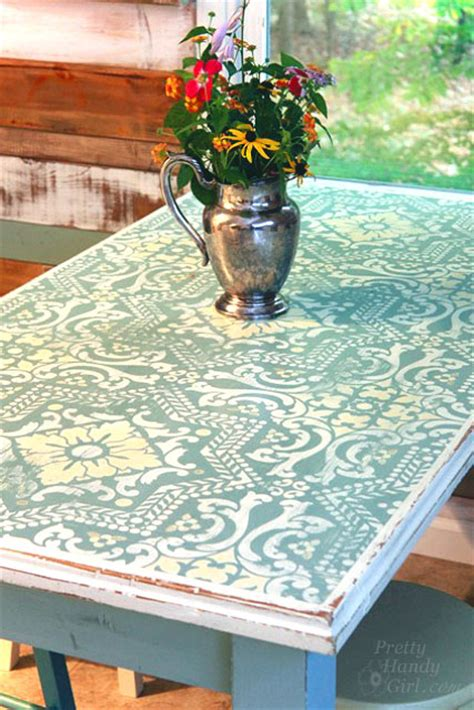 chalk painted stenciled and distressed dumpster table pretty handy