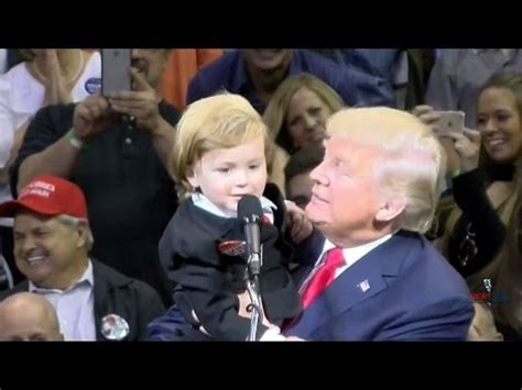 donald trump holding little boy little trump look alike comes on stage with donald in
