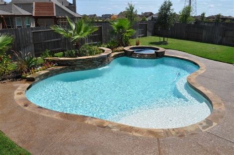 backyard tanning tips how to design a swimming pool using ledger stone and glass