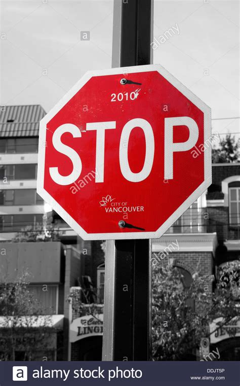 selective color and white stop sign selective colour stock photo