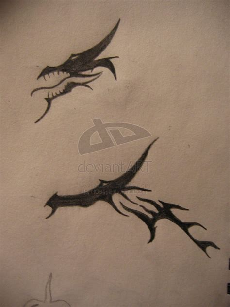 tribal dragon head tattoo images designs
