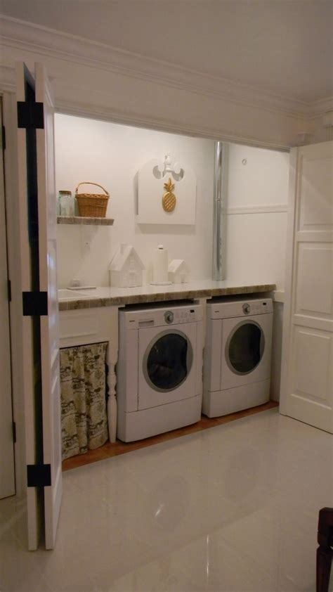 laundry in garage designs hide away laundry room there are poles up inside running the width of the area for items