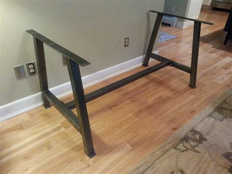 Table Supports by A Metal Table Base With Cross Bar