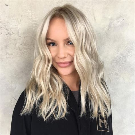 blunt end cut add texture women s wavy blonde blunt cut with textured ends and long