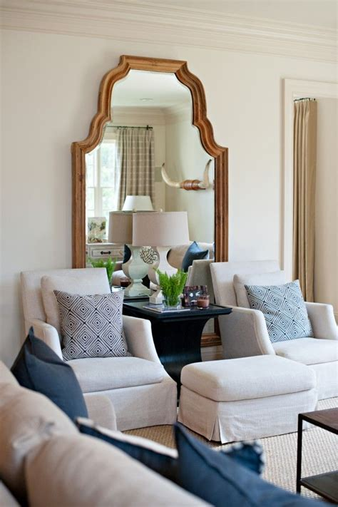 table between two armchairs big mirror table between two chairs with ottomans