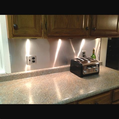 aluminum kitchen backsplash our low budget kitchen backsplash aluminum roof 17 dollars diy i ve done