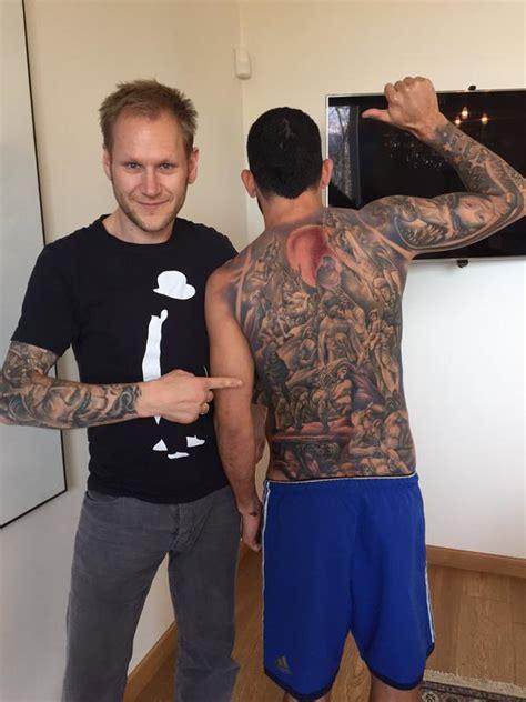 Back Tattoo Tevez | tevez shows off full body tattoo allsoccerplanet