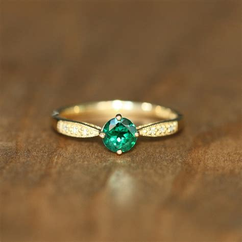 emerald engagement rings make a classic cool statement