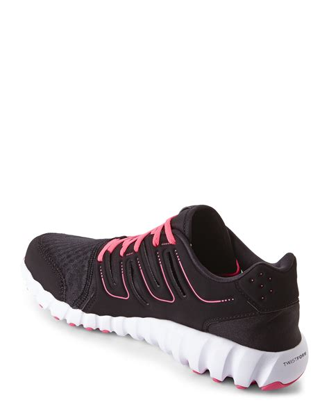 reebok black pink twistform running sneakers in black
