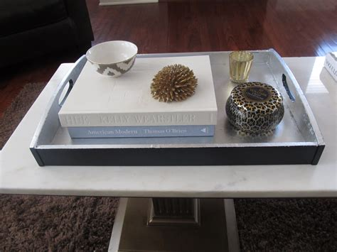 Square Wood Pedestal Coffee Table With White Marble Top And Small Silver Tray Table For