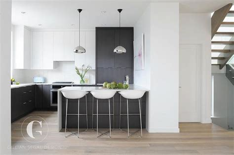 this inviting kitchen features flat front white cabinets modern black and white kitchen features white flat front
